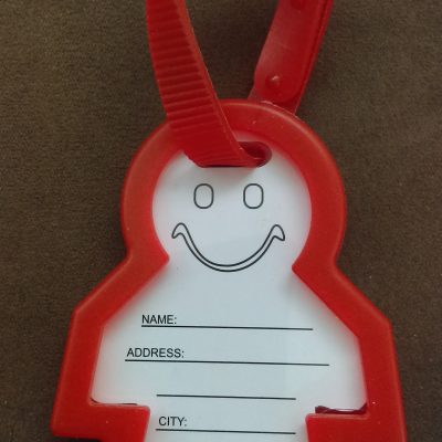Red Luggage Name Tag In Shape Of A Person