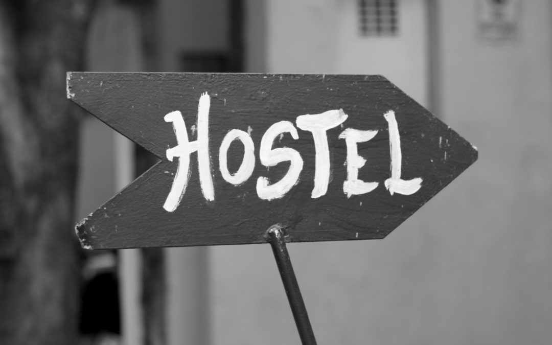 Black and White Pointing Hostel Sign.