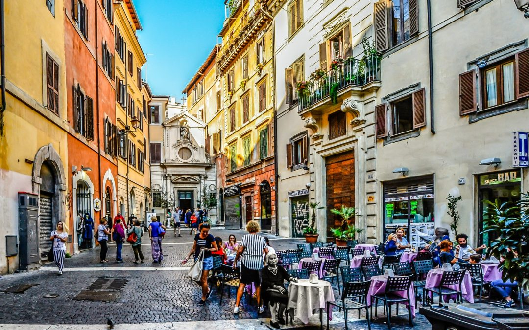 People Sitting At A Cafe In A Square In Rome, Italy.