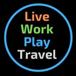 Live Work Play Travel Logo. Orange Live, Green Work, Blue Play, Grey Travel In A Blue Circle on A Black Background.