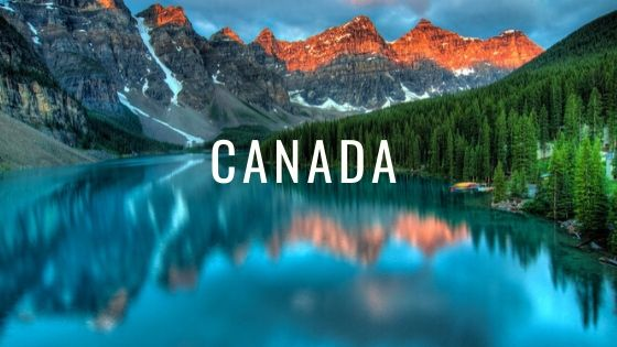 Mountains Reflecting In The Lake With The Word Canada.