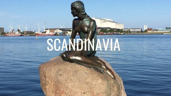 Mermaid Sitting On A Rock In Copenhagen Harbour, Denmark With The Word Scandinavia.