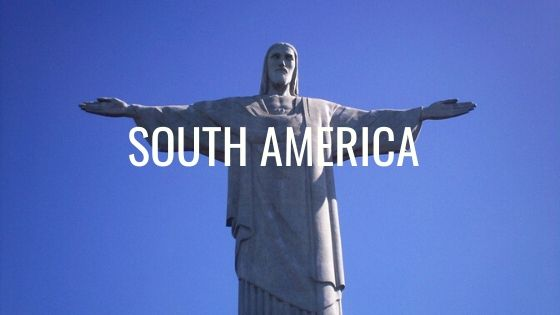 Christ The Redeemer With Blue Sky Behind Him With The Words South America.