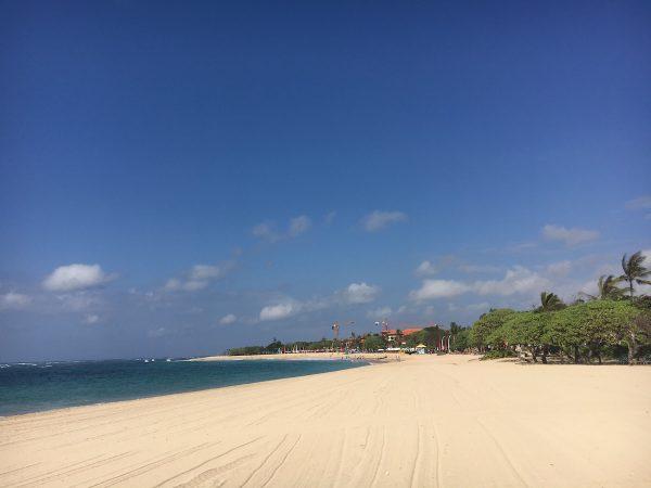 White Sand Beach With Blue Ocean In Bali.