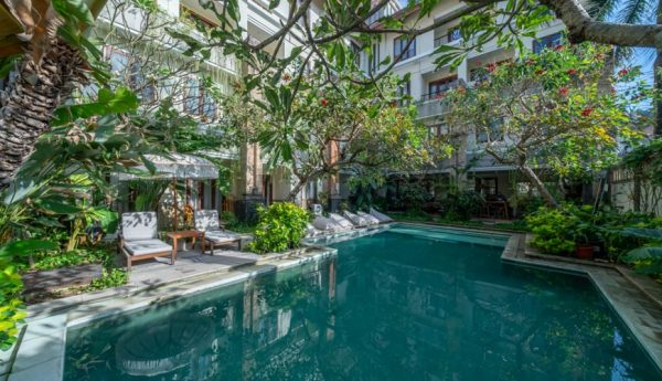 Pool With Chairs in A Courtyard In Bali