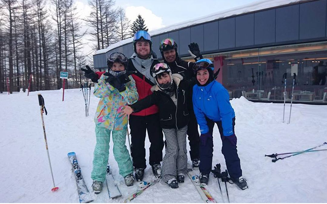 James King In The Snow With Young Skiiers He Is Teaching To Ski