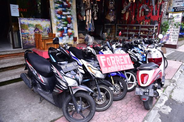 Motor Bikes In A Line For Rent On A Bali Street