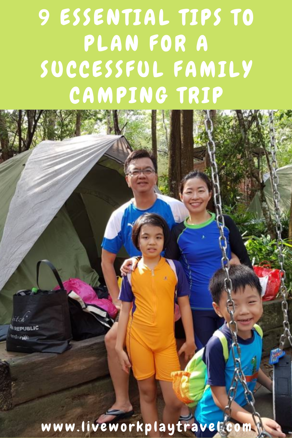 Family Standing In Front Of Their Tent On Their Family Camping Trip.