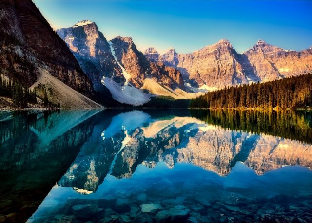 Lake Moraine. Crystal Clear Lake With Rocky Mountains Reflecting In The Lake In The Canadian Rocky Mountains.
