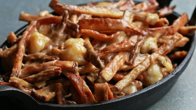 Poutine, A Canadian Classic Meal Of Chips, Cheese And Gravy.