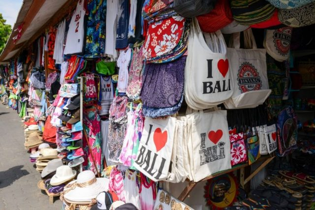 Market Stalls In Kuta With Hats, Sarongs and I Love Bali Bags.