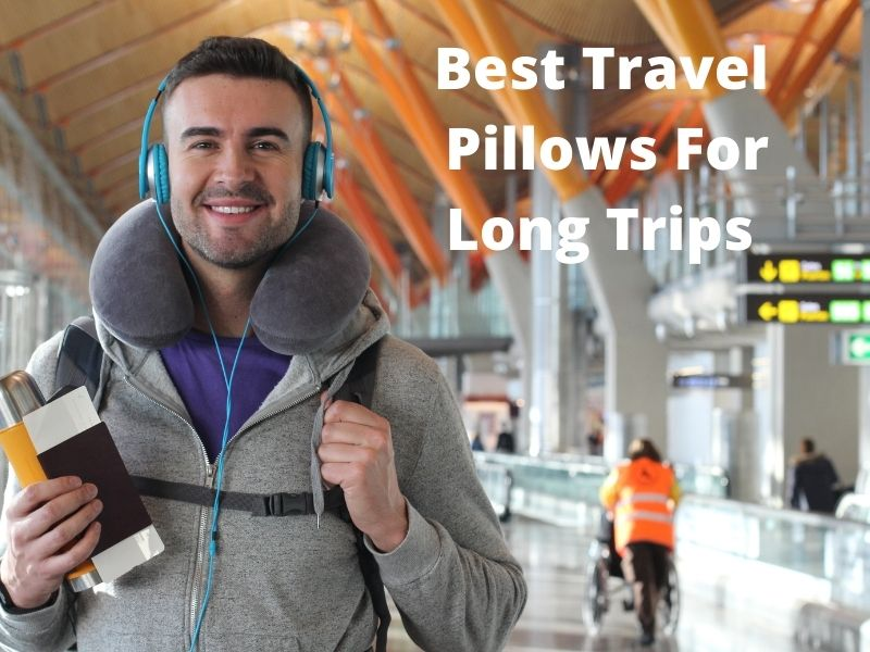 Male Person At Airport With A Travel Pillow Around Their Neck So They Get Sleep While Travelling.
