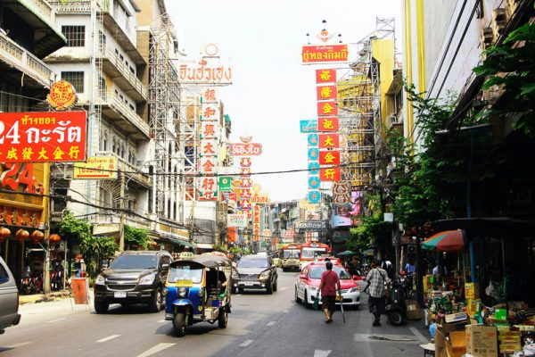 Chinatown In Bangkok Is Full Of The Hustle And Bustle Of Cars And People Stopping At The Chinese Stores For Produce And Great Chinese Meals.