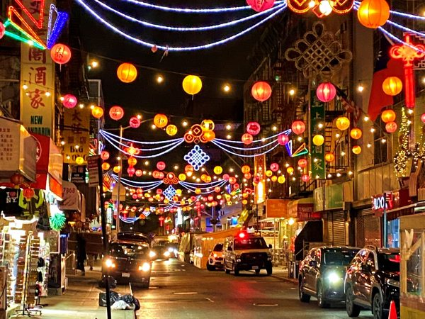 Chinatown New York City Has Many Chinese Red Lanterns Hanging From Structures like Many Chinatowns Around The World.