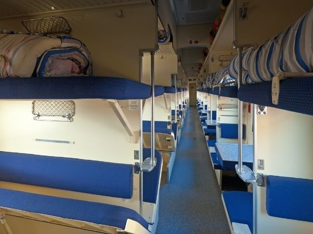 Beds In A Sleeper Compartment Of A Train.