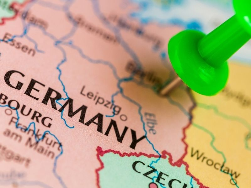 Close Up Of Map Of Germany With A Green Pin Pinned Into Berlin.