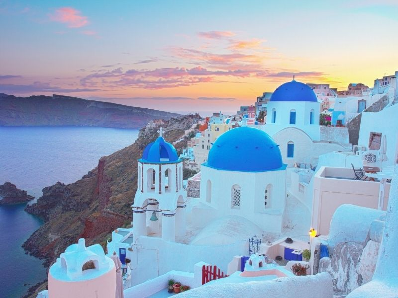 Beautiful White Washed Greek Town Overlooking The Ocean On Santorini.
