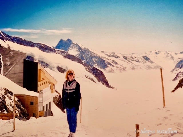 Sharyn McCullum Standing On Top Of Europe At Jungfraujoch Overlooking The Glacier And The Sphinx Observation Deck.