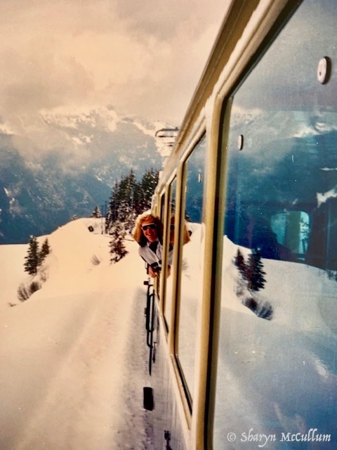 Sharyn McCullum Leaning Out Of A Train Window On The Way Up To Jungfraujoch. Snow Is All Around.