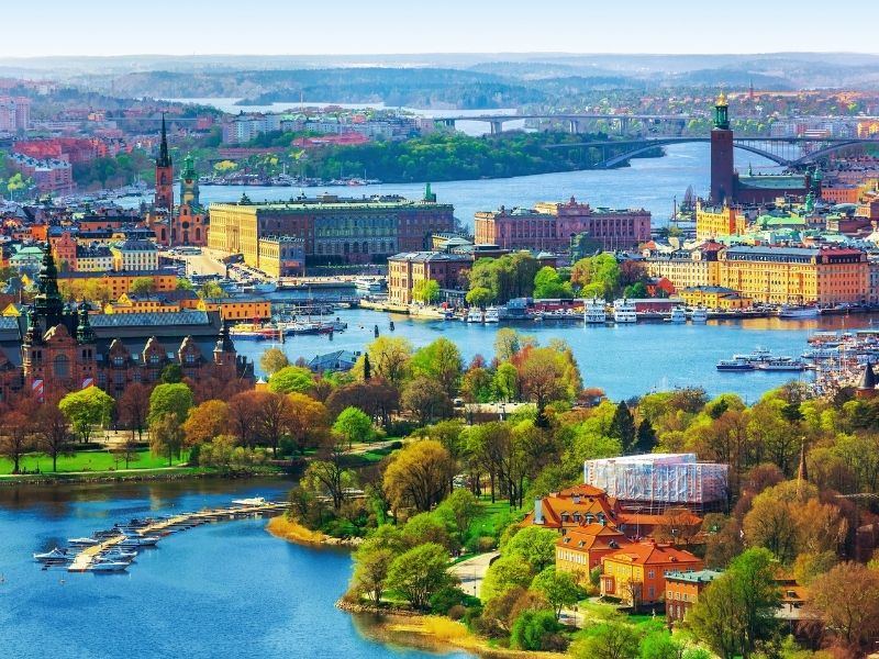 Aerial View Of Stockholm Showing The Islands, The Parks, The Beautiful Old Buildings And The Water Ways Of Stockholm.