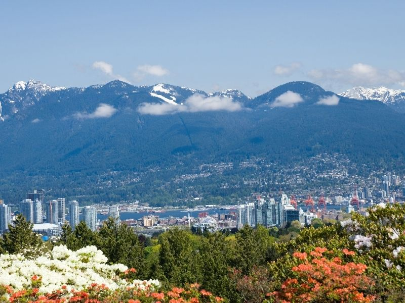 Vancouver City Surrounding By Snow Capped Mountains in Canada.