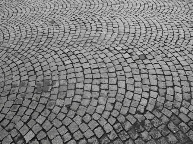 Paris Has Cobbled Streets With Cobbles Laid In A Fan Pattern.